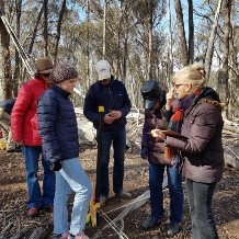 Sandra and Landholder plus volunteers at biodiversity site getting training on the checking for change process.