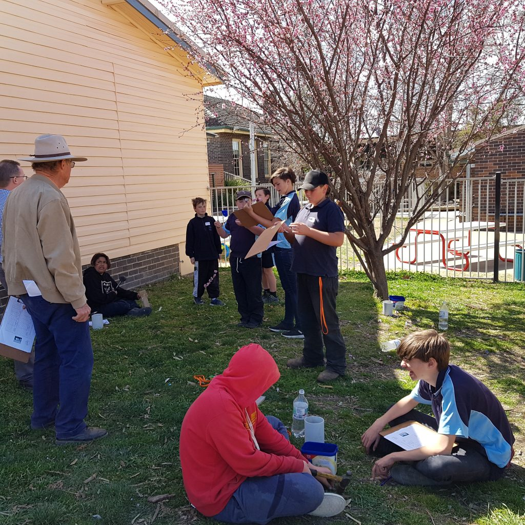Uralla Central School students doing an experiment on water infiltration.