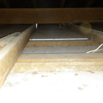Inside the roof cavity showing no insulation in the ceiling