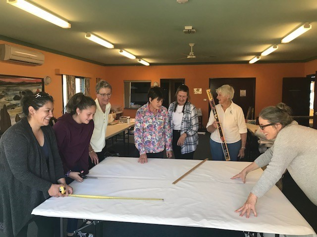 Attendees at Curtain making workshop learning about measuring up curtains