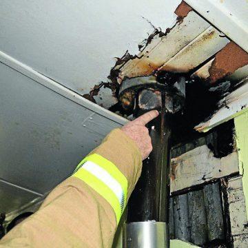 Burnt ceiling from flue setting on fire